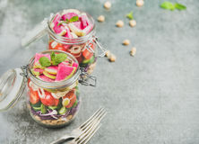 Healthy vegetarian salad in jars with vegetables and chickpea sprouts Stock Photo