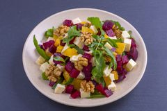 Healthy Vegetarian Salad With Beetroot, Green Arugula, Orange, Feta Cheese And Walnuts On Plate Stock Image