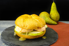 Healthy Vegetarian Veggie Sandwich with French soft cheese, pea. R and honing on black stone plate royalty free stock photo