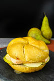 Healthy Vegetarian Veggie Sandwich with French soft cheese, pea. R and honing on black stone plate stock photo