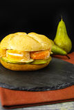 Healthy Vegetarian Veggie Sandwich with French soft cheese, pea. R and honing on black stone plate royalty free stock image