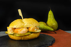 Healthy Vegetarian Veggie Sandwich with French soft cheese, pea. R and honing on black stone plate royalty free stock images