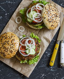 Healthy vegetarian zucchini burgers on dark  background. Royalty Free Stock Photography