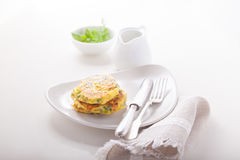 Healthy vegetarian zucchini fritters Stock Photos