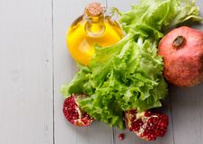 Healthy veggie salad ingridients. Pomegranate Royalty Free Stock Images