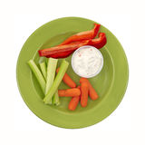 Healthy veggies on green plate Royalty Free Stock Photo