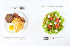 Healthy versus junk food. Contrasting healthy versus junk food stock photo
