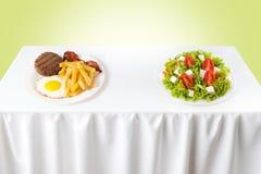 Healthy versus junk food. Contrasting healthy versus junk food Royalty Free Stock Photography
