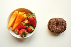 Healthy versus unhealthy breakfast Royalty Free Stock Photography