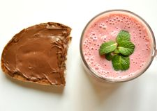 Healthy versus unhealthy breakfast : smoothie and chocolate Stock Photos