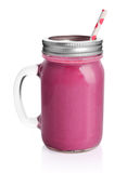 Healthy violet smoothie with straw. In a jar mug  on white Stock Images