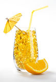 Healthy vitamin cocktail: yellow pills in glass Stock Image