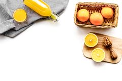 Healthy vitamin drink. Fresh orange juice near fruits and juicer on white background top view copyspace. Healthy vitamin drink. Fresh orange juice near fruits Royalty Free Stock Photos