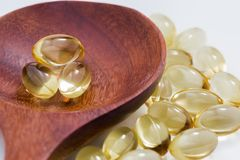 Daily health vitamins. Healthy vitamins are golden yellow on a white background Stock Photography