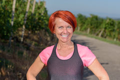 Healthy vivacious pretty redhead woman Royalty Free Stock Photography
