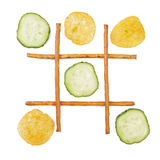Healthy vs unhealthy food. Tic-tac-toe game. Cucumber versus potato chips Stock Photo