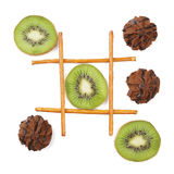 Healthy vs unhealthy food. Tic-tac-toe game. Kiwi fruit versus cookies Stock Image