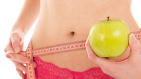 Healthy waist with measuring tape Stock Photo