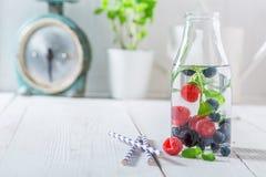 Healthy water in bottle with raspberries, blueberries and blackberries Royalty Free Stock Image