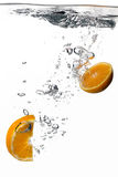Healthy Water with Fresh Oranges. Splash isolated on white Royalty Free Stock Image