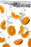 Healthy Water with Fresh Oranges. Splash isolated on white Stock Photos