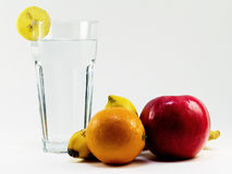 Healthy water and fruit vitamines. Glas of pure water with orange, lemon, banana and apple Stock Images
