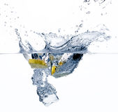 Healthy Water with Lemon. Splashing. Healthy Water with Lemon and Ice Cube Stock Photography