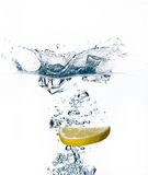 Healthy Water with Lemon. Splashing. Healthy Refreshment with Lemon and Ice Cube. Splashes Stock Images