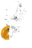 Healthy Water with Orange Slice. Drops Royalty Free Stock Images