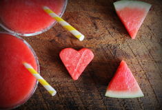 Healthy watermelon smoothie with of watermelon in heart shape on a wood background Stock Photo