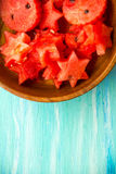 Healthy watermelon smoothie on a wood background and slices. Watermelon slice popsicles on a vintage blue rustic wood background. Stock Image