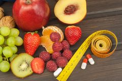 Healthy weight loss. Fruit, vitamins and sport. Stock Photo