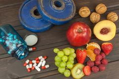 Healthy weight loss. Fruit, vitamins and sport. Royalty Free Stock Image