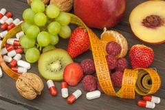 Healthy weight loss. Fruit, vitamins and sport. Royalty Free Stock Photos