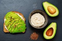 Healthy white bean hummus avocado rye breakfast sandwich Stock Photo