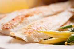 healthy white fish fillets with vegetables Stock Photo