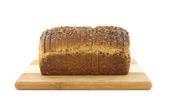 Healthy whole grain bread loaf on cutting board Royalty Free Stock Photography