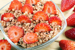 Healthy whole grain muesli and bran breakfast with strawberries Royalty Free Stock Images