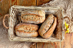 Healthy whole grain rolls. Close up of whole grain rolls placed in wooden bread basket Stock Photography