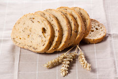 Healthy whole grain sliced bread with sunflower seeds on brown n Royalty Free Stock Photography