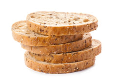 Healthy whole grain sliced bread with sunflower seeds on white b Stock Photo