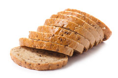 Healthy whole grain sliced bread with sunflower seeds on white b Stock Photos