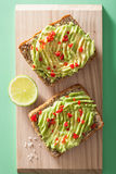 Healthy wholegrain bread with avocado lime chili Stock Photography