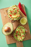 Healthy wholegrain toast with avocado lime chili Stock Photos