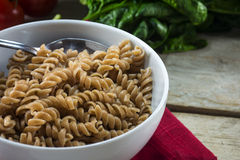 Healthy wholemeal pasta, spiral noodles from whole grain spelt i Royalty Free Stock Photos