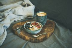 Rice coconut porridge with figs, berries and hazelnuts and coffee. Healthy winter breakfast in bed. Rice coconut porridge with figs, berries and hazelnuts in Royalty Free Stock Images