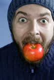 Healthy winter nutrition concept - man and apple Stock Photography
