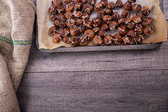 Healthy winter snack chestnuts on wooden background Stock Photo