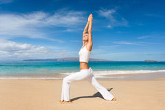 Healthy woman. Healthy happy woman doing exercise yoga on tropical beach Royalty Free Stock Images