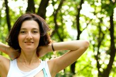 Healthy woman. Portrait of a beautiful healthy woman in the forest Stock Images